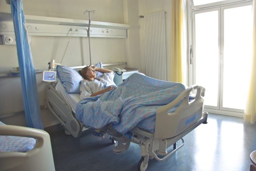 photo-of-woman-lying-in-hospital-bed-3769151